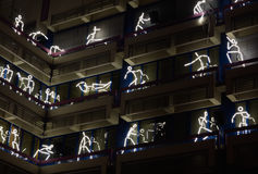 Figures on building during lightshow Glow 2012 Stock Image