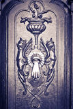 Figures carved door, with knocker, black & white Stock Image