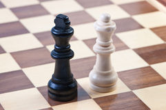 Figures on the chess board. Royalty Free Stock Photo