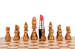 The figures on the chess board, led by red lipstick Royalty Free Stock Photography