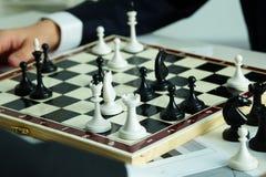 Figures on chessboard stock photos