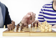 Figures on a chessboard Stock Photos