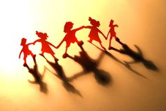 Figures of children in dance. The silhouettes of children which have been cut out from a cardboard. Please, if probably, write, where you wish to use this card Stock Image