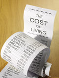 Figures for the cost of running home finances on a paper printout. Royalty Free Stock Images