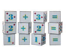 Figures on cubes Stock Photography