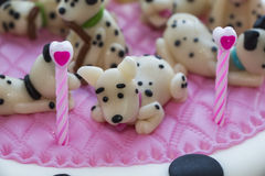 Figures Dalmatian puppies of marzipan Royalty Free Stock Photos