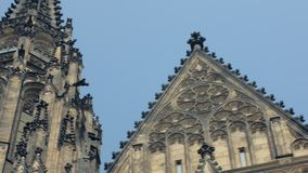 Figures and decorations on facade and towers of old gothic cathedral. Panoramic view stock video footage