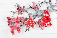 Figures deer, stars and Christmas tree on a branch with berries Royalty Free Stock Photography