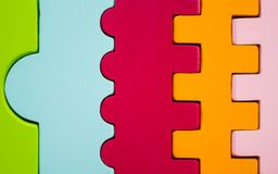 The figures of different colors and forms bonded together. Children`s toy stock photography