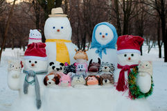 Figures of dressed snowmen in winter Royalty Free Stock Photos