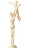 Figures en bois de l'enfant carring de parent supplémentaire Photo libre de droits