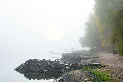 Figures of the fishermen in the fog Stock Photography