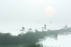 Figures of the fishermen in the fog Royalty Free Stock Images