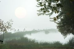 Figures of the fishermen in the fog. The figures of the fishermen in the fog stock photos