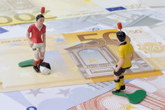 Figures of football players on banknotes Stock Images