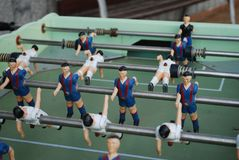 Figures of football players from metal, in blue-red form. Table soccer Stock Photos