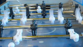 Figures of footballers move left and right people playing foosball. table soccer plaers. table football soccer game. Kicker stock video