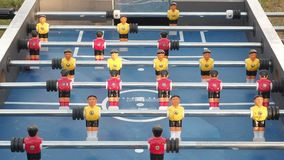 Figures of footballers move left and right people playing foosball. table soccer plaers. table football soccer game. Kicker close up stock footage