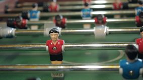 Figures of footballers move left and right people playing foosball. table soccer plaers. table football soccer game. Kicker stock footage