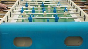 Figures of footballers move left and right people playing foosball. table soccer plaers. table football soccer game. Kicker close up stock video footage