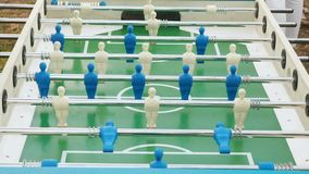 Figures of footballers move left and right people playing foosball. table soccer plaers. table football soccer game. Kicker close up stock video