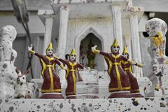 Figures in front of a temple in Thailand royalty free stock images