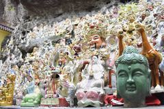Figures of gods and green head near the temple in Asia royalty free stock image