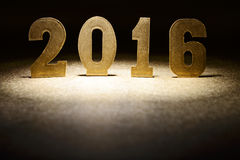 Figures 2016 on a gold background stock photography