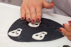 Figures of Halloween with fondant paste or sugar paste. Pastry lesson, working on the figures of Halloween with fondant paste or sugar paste royalty free stock image