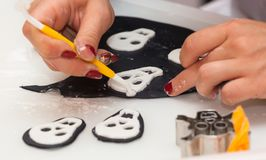 Figures of Halloween with fondant paste or sugar paste. Pastry lesson, working on the figures of Halloween with fondant paste or sugar paste royalty free stock photography