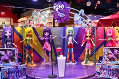 Figures of heroines and soft toys cartoon characters My Little Pony: Equestria Girls in the store Children`s world. Moscow. 14.12. Figures of heroines and soft royalty free stock image
