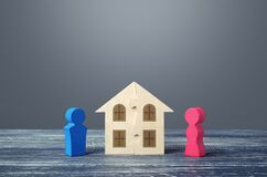 Figures of husband and wife and house puzzle. Marriage contract. Buying or building a dream home. Division of marital property