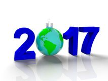 The figures in 2017, with the image of the ground like a toy for  Christmas tree, in the form  the planet Earth, on Royalty Free Stock Photo