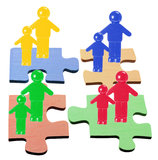 Figures on Jigsaw Puzzle Pieces Royalty Free Stock Photos