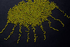 Figures from lentils on grey table Royalty Free Stock Photos