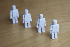Figures lining up Royalty Free Stock Images