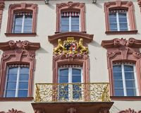 Facade of old city hall (1741) in Offenburg, Germany. Figures of lions holding coat of arms (facade of old city hall circa 1741). Offenburg, Baden-Wurttemberg Royalty Free Stock Images