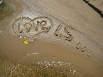 Figures love on sand. View of figures love on sand Stock Image
