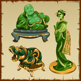 Figures from malachite Buddha, geisha and animal Royalty Free Stock Images