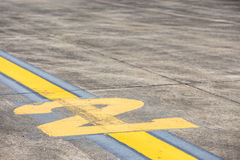 Figures on the maneuvering area of an airport. Stock Image