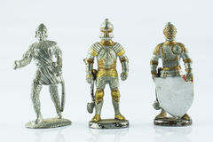 Figures of medieval knights. Three old figures of medieval knights Royalty Free Stock Photos