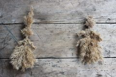 Figures of men made from the dry bulrush. Figures of men made by children of dry bulrush stock photography