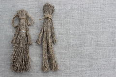 Figures of men made from the dry grass Royalty Free Stock Photo