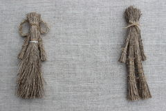 Figures of men made from the dry grass Stock Images