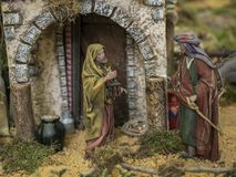 Figures of men next to a house. Decorative figures of traditional in Christmas of the portal of belen stock photo