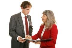 figures mentoring som granskar försäljningsserie Royaltyfria Foton