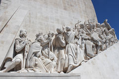 Figures on the Monument of the Discoveries. Details of statuary on the Monument of the Discoveries Padrao dos Descobrimentos in Lisbon, Portugal Royalty Free Stock Photos
