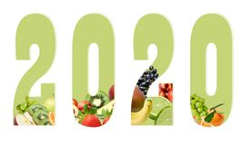Figures of the new year 2020 on a white background decorated with fruit composition below.  Design element for print or web stock photography