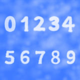 Figures and numbers on a background of blue sky with clouds Stock Photo