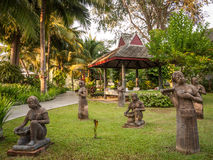 Figures in a park, Thailand Stock Photography